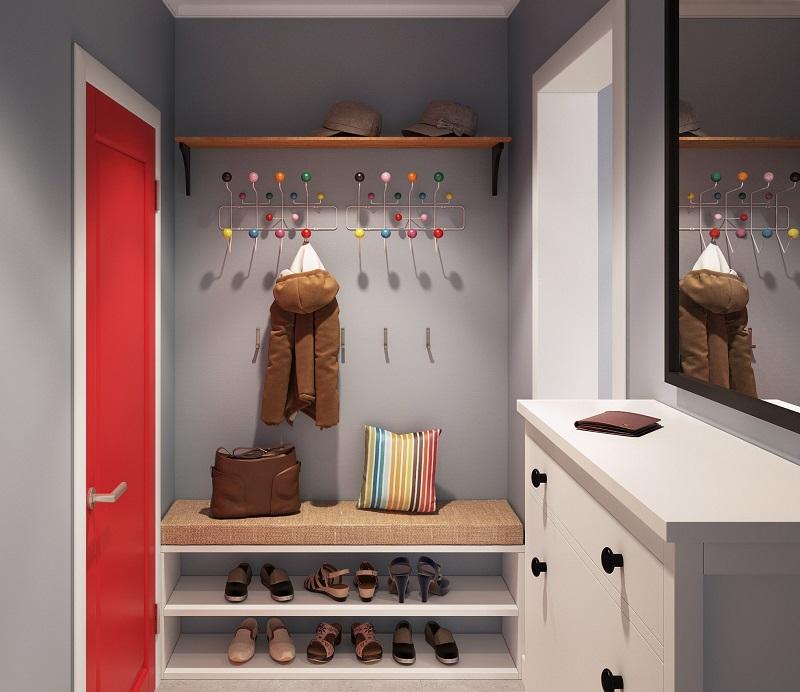 Hall com detalhes coloridos, sapateira, espelho e cabides